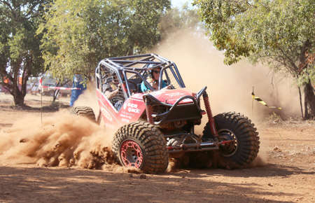 Rustenburg, South Africa – JUNE 17, 2017: National Extreme Modified 4x4 Vehicle Championship. Red car kicking up dust during speed timed trial event of competition. Editorial
