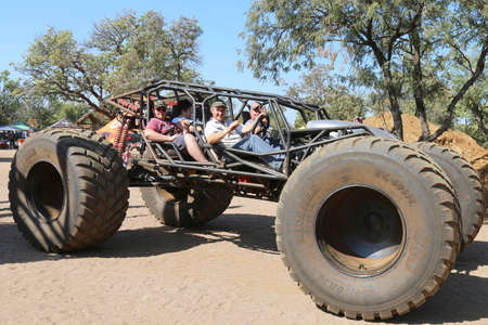Rustenburg, South Africa – JUNE 17, 2017: National Extreme Modified 4x4 Vehicle Championship. Public taken on big foot open sided large 4x4 joy ride. Editorial