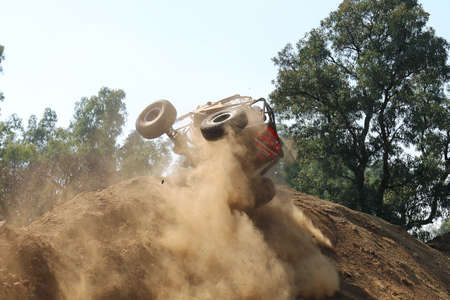 Rustenburg, South Africa – JUNE 17, 2017: National Extreme Modified 4x4 Vehicle Championship. Red Car rolling over at the top of very steep hill.