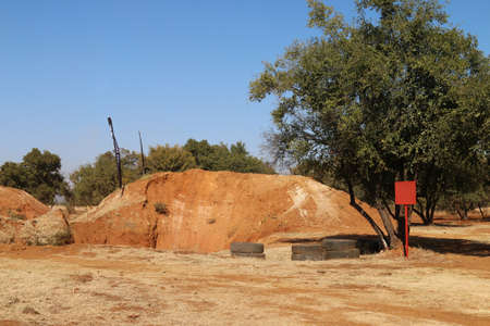 Rustenburg, South Africa - JUNE 17, 2017: National Extreme Modified 4x4 Vehicle Championship. Sand mountain from dugout at 4x4 circuit with no cars on it. Editorial