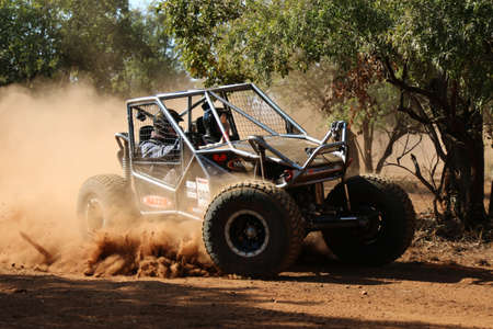 Rustenburg, South Africa - JUNE 17, 2017: National Extreme Modified 4x4 Vehicle Championship. Black car kicking up dust during speed timed trial event of competition.
