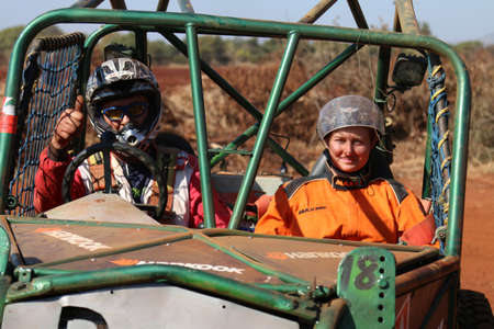 Rustenburg, South Africa - JUNE 17, 2017: National Extreme Modified 4x4 Vehicle Championship. Male driver thumbs up with female co-driver after completing obstacle.