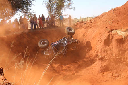 Rustenburg, South Africa - JUNE 17, 2017: National Extreme Modified 4x4 Vehicle Championship. Black car rolling in dugout sequence of photos. Car rolling over. 3 of 6 Editorial