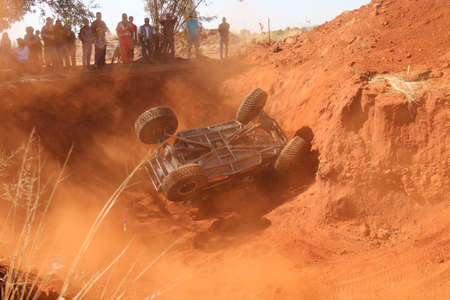 Rustenburg, South Africa - JUNE 17, 2017: National Extreme Modified 4x4 Vehicle Championship. Black car rolling in dugout sequence of photos. Car rolling over on top of cage. 4 of 6