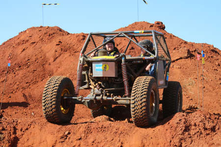 Rustenburg, South Africa - JUNE 17, 2017: National Extreme Modified 4x4 Vehicle Championship. Car waiting on edge to start descent into dugout. Editorial