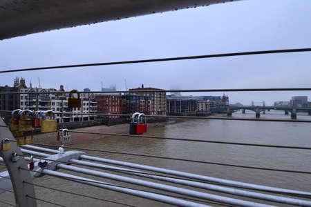 hand rail: Love locks on the Millennium bridge in London