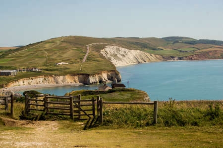 wight: Freshwater bay on the Isle of Wight with white limestone cliffs behind.