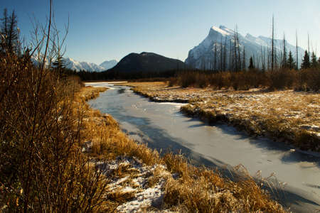 rockies: A frozen river in the middle of winter in the canadian rockies
