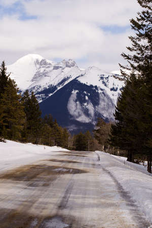 ice covered: Ice covered road leading into the mountains Stock Photo