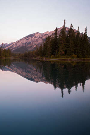banff national park: Early morning reflections on the Bow river, Banff national park. Stock Photo