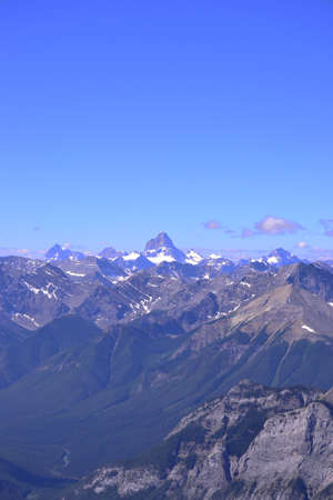 rockies: A zoomed out view of Mount Assiniboine and the surrounding valleys in the Canadian rockies.