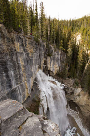 canadian rockies: Panther falls in the Canadian rockies, its late fallautumn and the water is cold enough to freeze as it hits the rocks below the falls. Stock Photo
