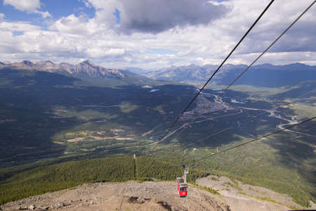 rockies: A cable car coming up the mountain above Jasper in the Canadian rockies.