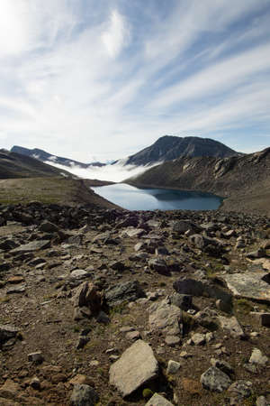 canadian rockies: A mountain tarn high up in an alpine area of the Canadian rockies