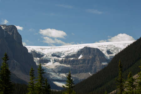 canadian rockies: A glacier tumbling off the top of a mountain high in the Canadian rockies. Stock Photo