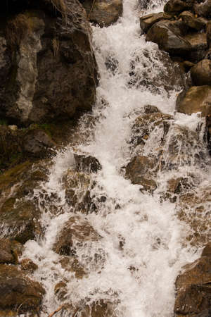no rush: A detailed view of a river running between steep rocks.