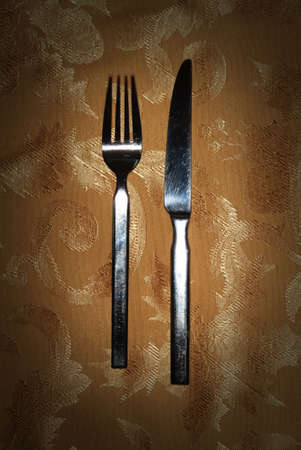 close up of fork and knife on napkin