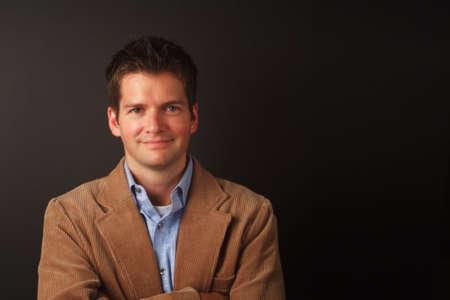 studio shot of man with brown jacket photo