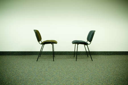 two chairs in office facing each other