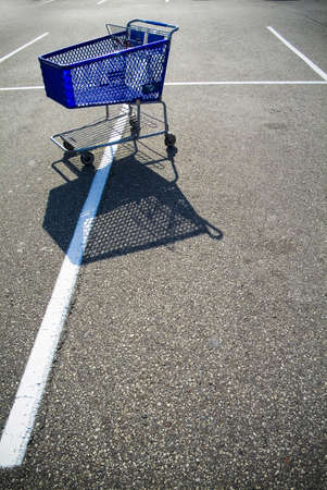 large shopping cart in parking lot photo