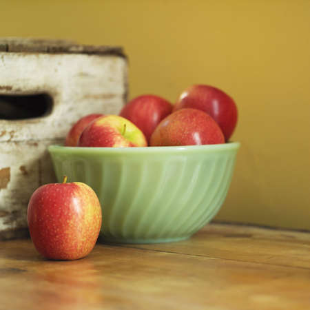 studio shot of apples in bowl