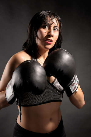 intimidate: Female boxer challenging the camera