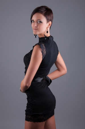 Beautiful woman in a black elegant evening dress photo