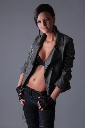 beauty youn woman with leather jacket and jeans photo