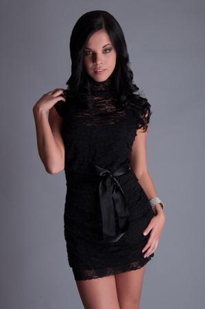 Beautiful woman in a black elegant evening dress photo