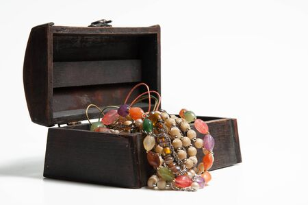 br: Jewellery in old wooden box Stock Photo