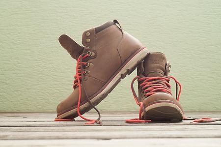 Light brown boots on wooden floor photo