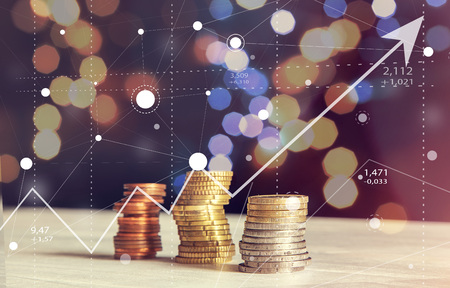Abstract Stock Business Charts of Graph with Coins and Blurred Background