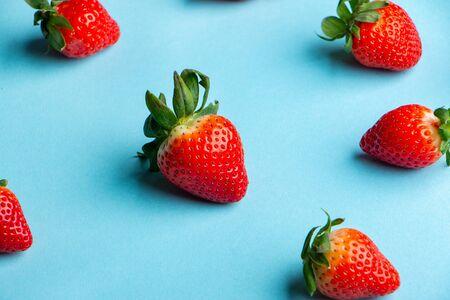 Heap of Fresh Strawberries on Light Blue