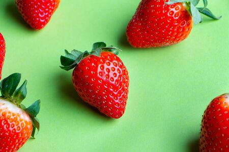 Heap of Fresh Strawberries on Light Green