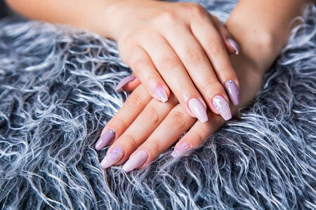 Perfect Manicure with Trendy Nail Art on Fake Gray Fur Pelt
