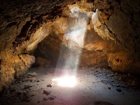 Sun Beams Shine Down Through Cave Ceiling 2