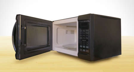 Black Microwave with Door Open on Wooden Countertop
