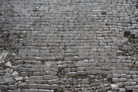 A closeup of a stone wall at Chichen Itza. photo