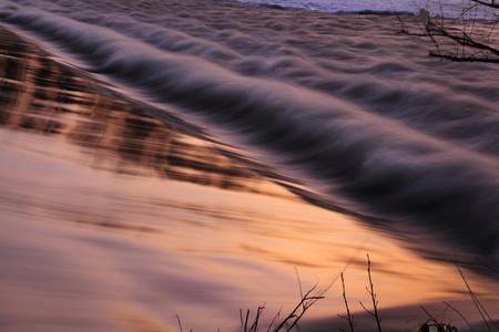 A little dam in the evening sun photo