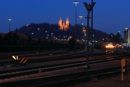 the train station of schwandorf with the beautiful church behind photo