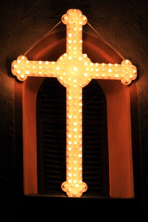 beautiful cross at the tower of a church photo