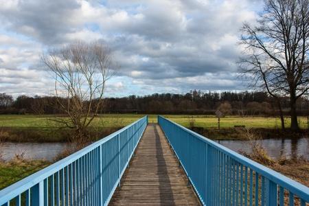 a little blue bridge over a small river Stock Photo - 16249405