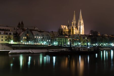 Regensburg at night with snow in winter photo