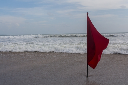 Red flag at Seminyak Beach in Bali photo