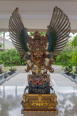 A dragon statue at the entrance of a hotel in Bali photo