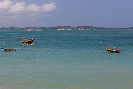 fishing boats in the ocean in Sri Lanka photo