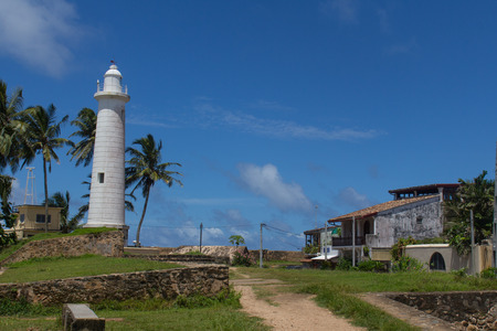 Scenic view at white lighthouse in Galle fort, Sri Lanka during sunny day  photo