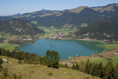 Hiking in the Alps at the at the Walchsee in Austria photo