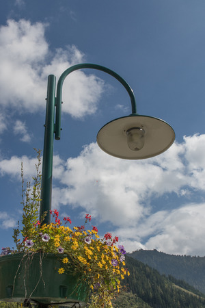 a street lamp with flowers Stock Photo
