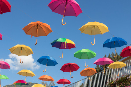 multi color umbrellas floating in Werfenweng, austria
